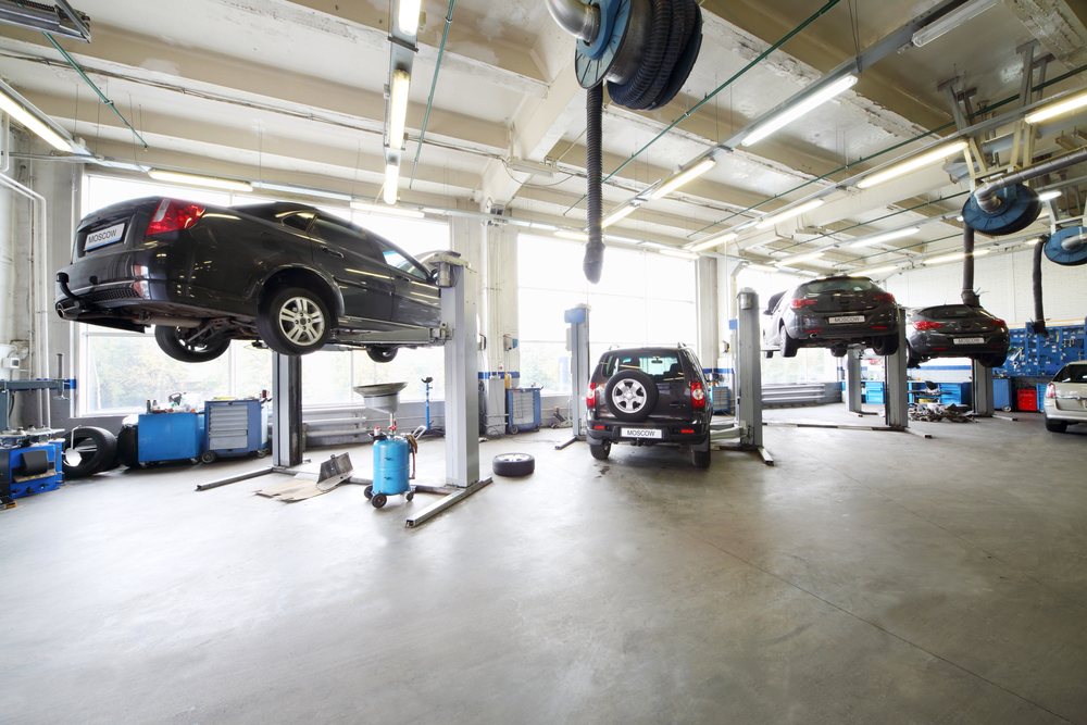 New certified car repair shop in qatar is open for for Mechanic shop flooring