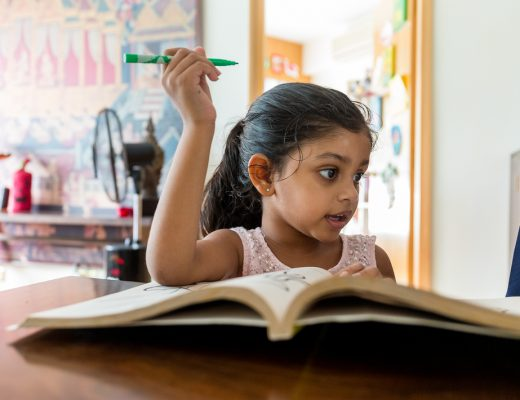 Arab Literacy Rate - Arab girl reading a book at home
