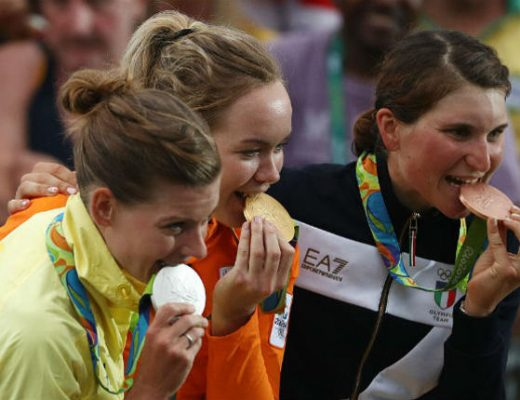 Olympian at Rio 2016 biting their medals