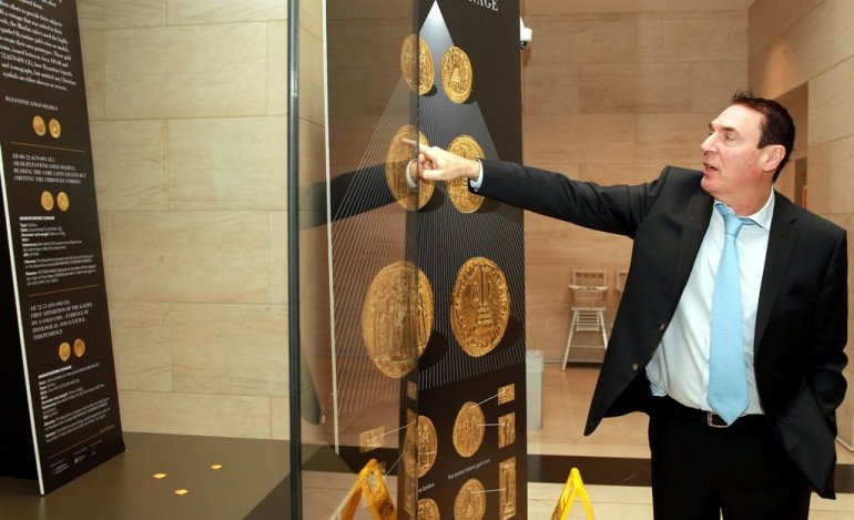 Dr. Alain Baron pointing at the coins at the Museum Of Islamic Art - Qassim Rahmatullah/The Peninsula