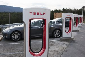 Tesla Superchargers with two Model S electric vehicles charging in Virginia, USA
