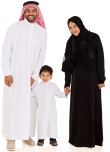A family in traditional Qatari clothing.
