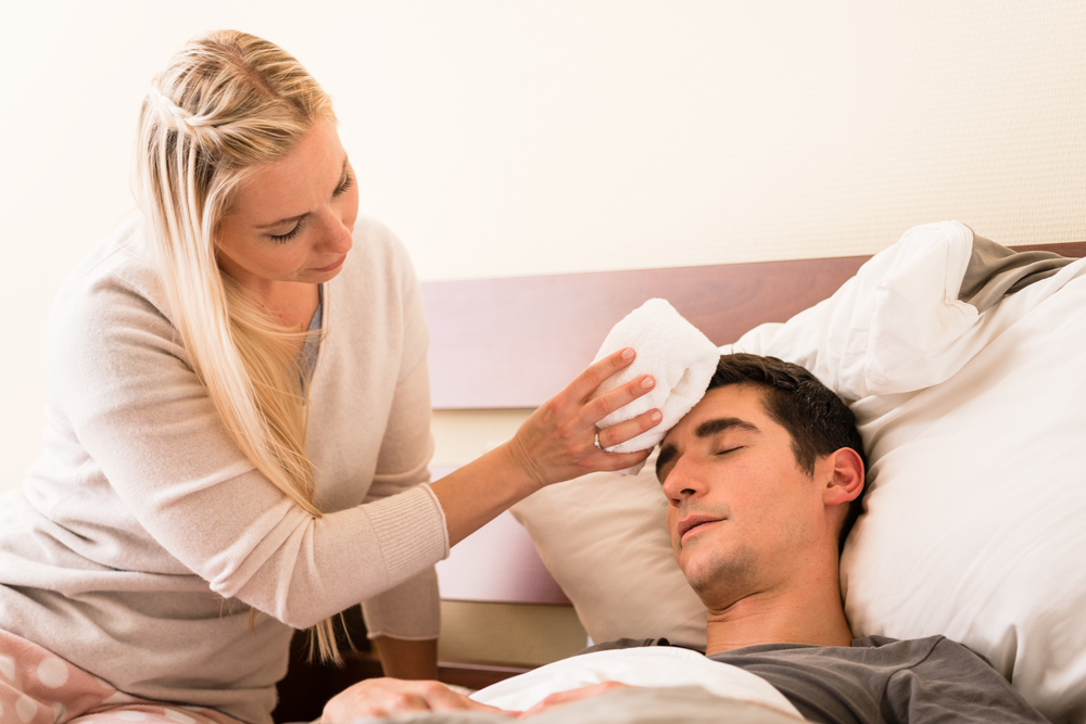 Woman taking care of a sick man