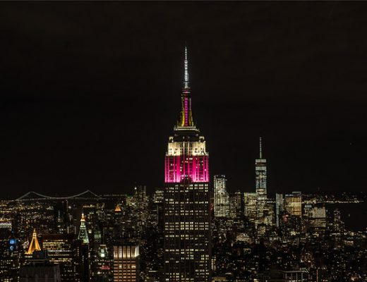 The Empire State Building illuminated in the colors of Qatar Airways