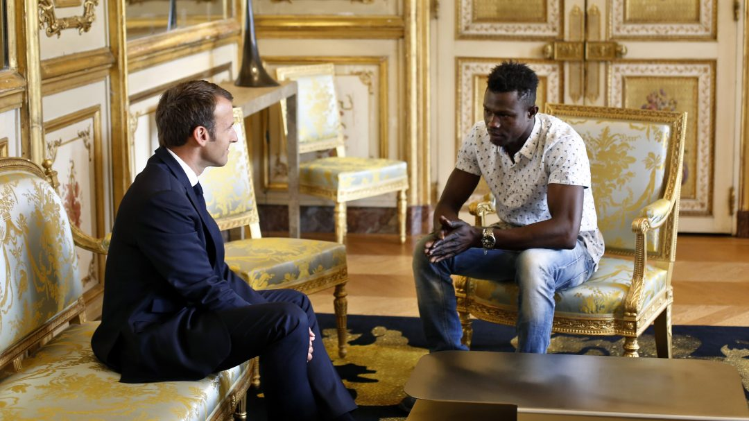 French President Emmanuel Macron met with immigrant hero Mamoudou Gassama to congratulate his heroic act - Independent/AP