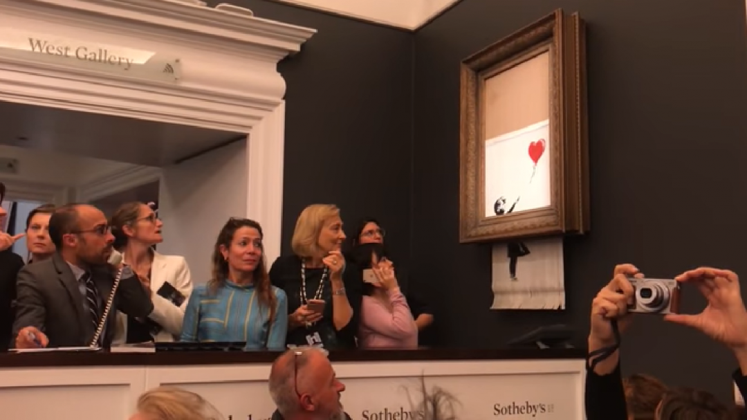 artist Banksy activated a built-in shredder in one of his paintings during Sotheby's auction