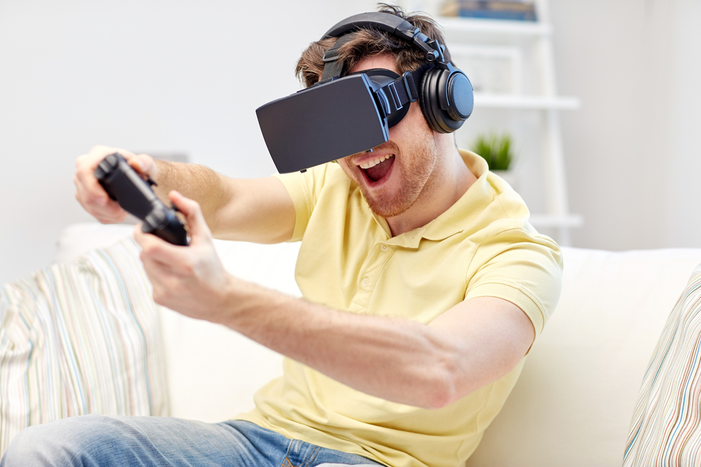 Man gaming with VR goggles on