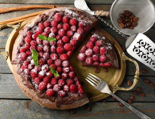 A Lazy Cake Cake garnished with berries and powdered sugar