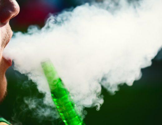 The smoke from a person smoking shisha